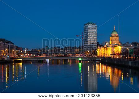 Buildings at the Liffey riverbank in the early morning. Dublin, Ireland.
