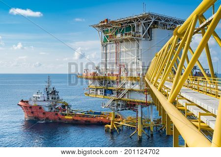 Supply boat come to oil and gas accommodation platform to send food and drink material . Oil and gas business in the gulf of Thailand.