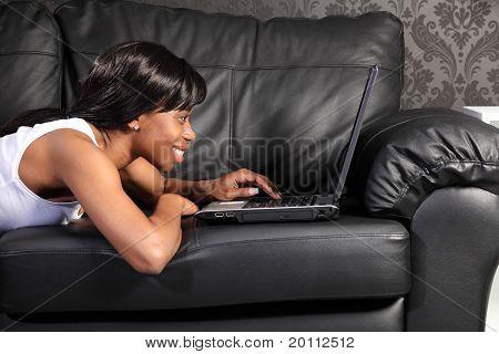 Beautiful Black Woman At Home Using