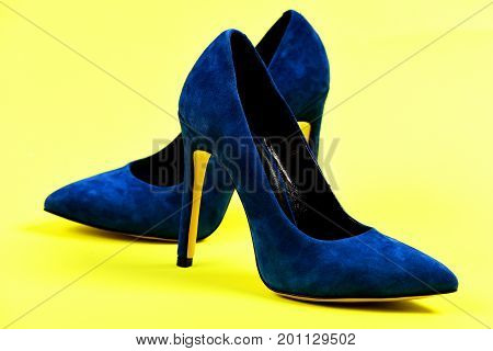 Elegant Blue Shoes Isolated On Yellow Background As Fashion Concept