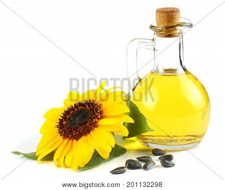 Sunflower oil, seeds and flower isolated on white background