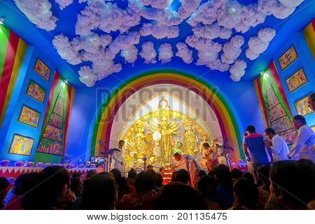 KOLKATA INDIA - OCTOBER 9 2016 : Priest praying to Goddess Durga Durga Puja festival celebration. Biggest religious festival of Hinduism and Kolkata's Bengali Community. Documentary editorial.