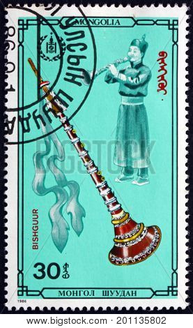 MONGOLIA - CIRCA 1986: a stamp printed in Mongolia shows Bishguur Mongolian Musical Instrument circa 1986