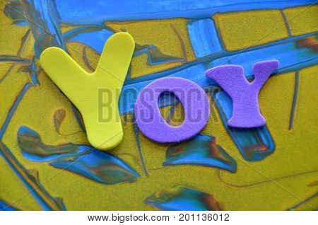 WORD YOY ON A   ABSTRACT COLORFUL BACKGROUND