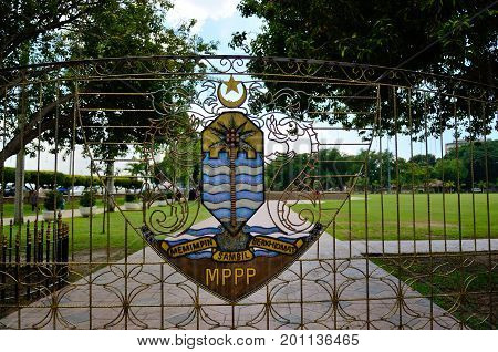 Georgetown/Malaysia - September 2012: Georgetown's coat of arms at the gate to the park on the waterfront Georgetown Penang Island Malaysia.