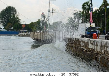 Georgetown/Malaysia - September 2012: The wave breaks down on the Georgetown quay Penang Island Malaysia.
