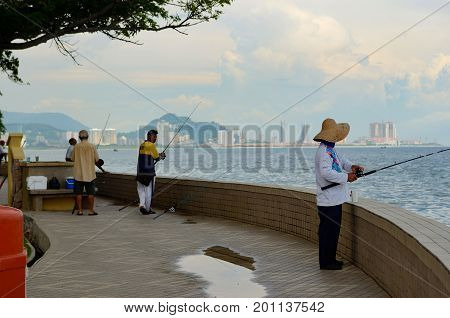Georgetown/Malaysia - September 2012: Fishermen on the waterfront of Georgetown Penang Island Malaysia.