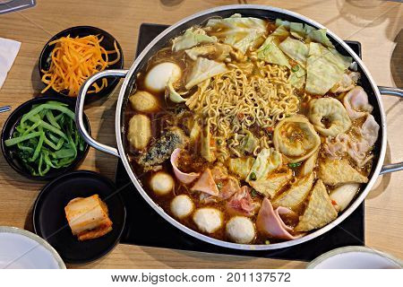 Budaejjigae delicious Korean noodles in a pot with Vegetable set for Family. Korean food.