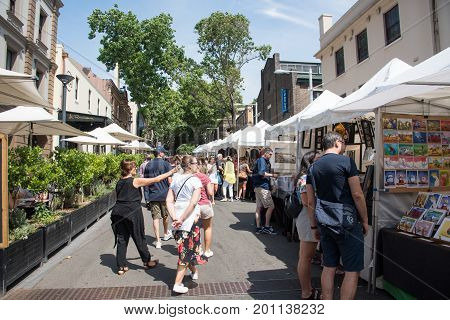SYDNEY,NSW,AUSTRALIA-NOVEMBER 20,2016: People shopping at The Rocks open-air markets in Sydney, Australia.