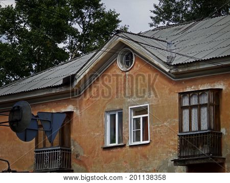 Kazakhstan, Ust-Kamenogorsk - 01, August 2017. A fragment of an old building on Gogol street.Architecture. Old architecture. Old building. Architectural background.
