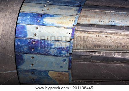 Jet engine close up. Metal surface of reactive engine