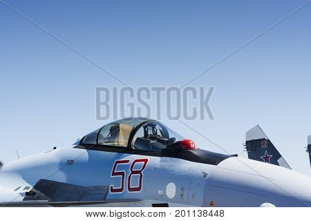 Military aircrafts exhibition with clean blue sky. Cabin of fighter jet
