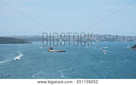 SYDNEY,NSW,AUSTRALIA-NOVEMBER 20,2016: Elevated view over nautical vessels and Fort Denison with Martello Tower in the Parramatta River in Sydney, Australia.