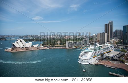 SYDNEY,NSW,AUSTRALIA-NOVEMBER 20,2016: Sydney Opera House at Bennelong Point with Cruise Ship docked in the Circular Quay in Sydney, Australia