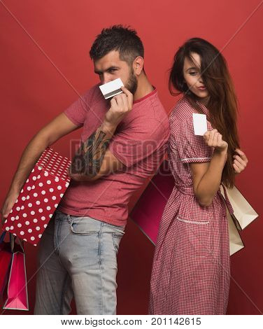 Couple In Love Holds Shopping Bags, Shows Credit Cards
