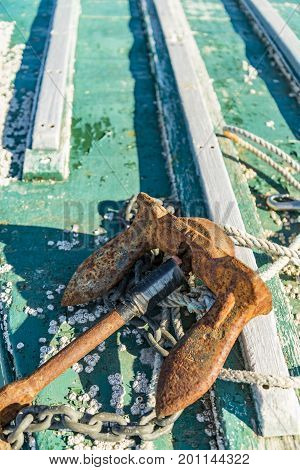 Close-up of rusted anchor on a boat in Maine