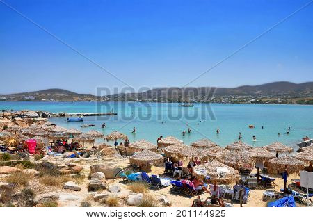 Paros Greece - July 24 2017:Kolimbitres beach with people and beach umbrellas