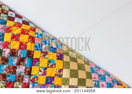 homemade, patchwork, quilting, sewing, comfort concept - multicolored handmaded blanket in best russian traditions made of textile squares with floral and abstract prints