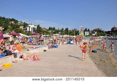 Portoroz Slovenia - 20 July 2016: Beach in Portoroz destination resort with bathing people in Slovenia