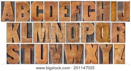 complete English alphabet - set of 26 isolated vintage wood letterpress printing blocks, scratched and stained by ink patina,  gothic bold extended font