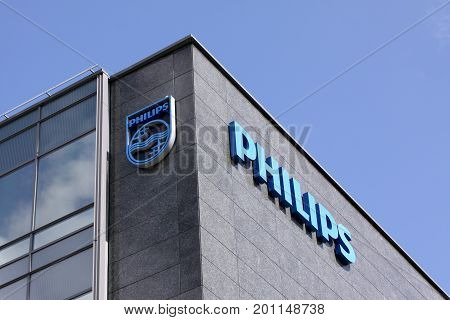 Philips company logo sign on building. Philips is a Dutch technology company headquartered in Amsterdam with primary divisions focused in the areas of electronics, health care and lighting. Copenhagen, Denmark, August 22, 2017.