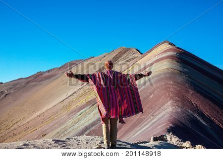 Hiking scene in Vinicunca, Cusco Region, Peru. Montana de Siete Colores,  Rainbow Mountain.