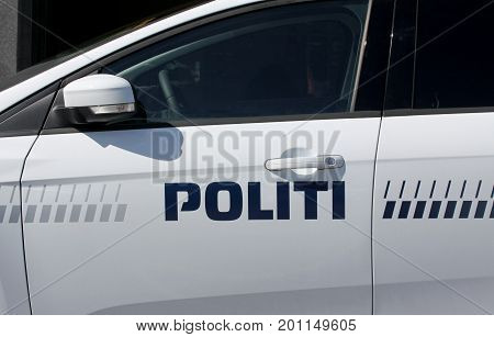 Police car with lettering and blue light. Denmark.
