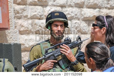 Undefined Israeli Soldier Laughing. Hebron Streets