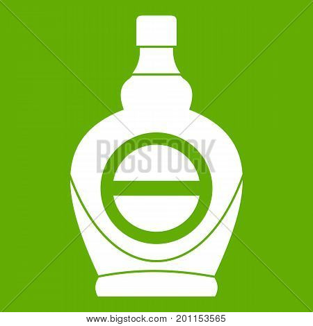 Maple syrup in glass bottle icon white isolated on green background. Vector illustration