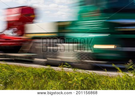Truck Transport On The Road With Motion Blur. Blurred Image Background. Colorful Wallpaper With Copy