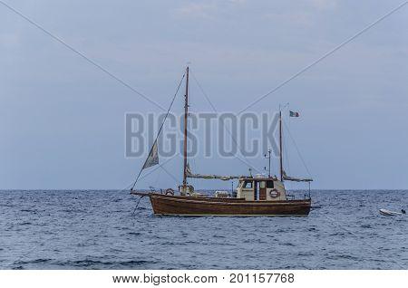 Sailboat sailing with its lifeboat on the Aeolian Islands tyrrhenian sea