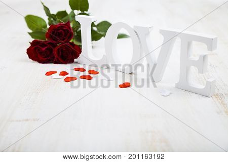 Red Roses And The Word Love