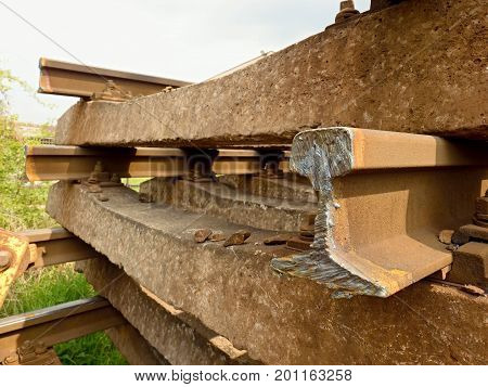 Cut Rusty Rails. Stock Of Steel Rails At Old Closed Railway Station. Transport To Steel Foundry For