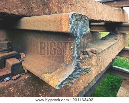 Stolen Rail. Detail Of Autogen Torch  Cut Rail Rod On Concrete Sleeper. Repair Of Tramway.