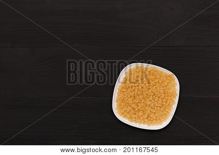 Wooden table top view. On the table are the food for cooking. Healthy food. Dietetic foods. Above view on food. uncooked pasta in a dish top view. Raw pasta in bamboo bowl on wooden background.