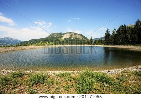 The Einstein mountain in the Tyrolean Alps with storage pond