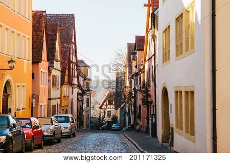 View of a beautiful street with traditional German houses in Rothenburg ob der Tauber in Germany. Europe.