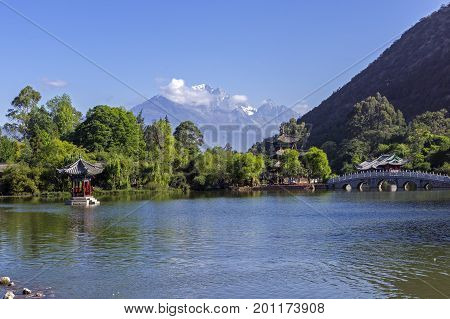 Lijiang old town scene-Black Dragon Pool Park. In there, you can see Jade Dragon Snow Mountain
