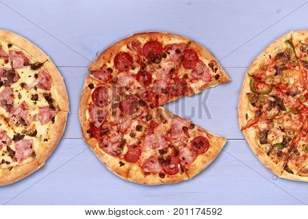 Pizza on wooden table top view. Fast food Delicious. Post blog social media. View from above with copy space. Banner template layout mockup top view on pizza. Pizza ready to eat.