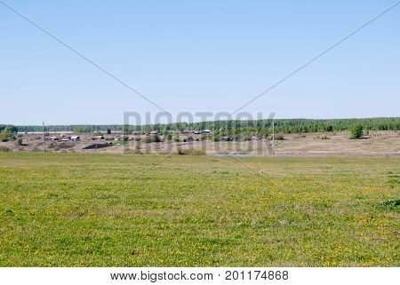 View to the Urals traditional Village and field, early spring, Sverdlovsk oblast, Russia