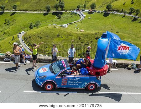 Col de PeyresourdeFrance- July 23 2014: X-tra vehicle during the passing of the Publicity Caravan on the road to Col de Peyresourde in Pyrenees Mountains in the stage 17 of Le Tour de France on 23 July 2014.