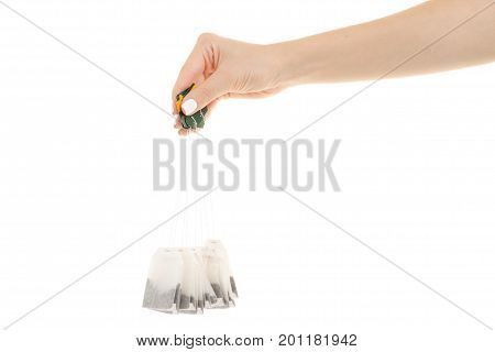 Lots of sachets of black tea on white background isolation
