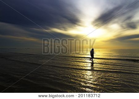 The beach Thung Wua Lan Beach idyllic with silhouette morning at Chumphon Province Thailand is famous for travel