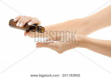 Female hands with a cotton disc and tonic medical alcohol on a white background isolation