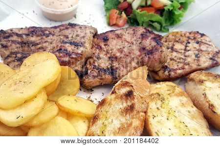 Grilled Steak With Potatoes And Toasted Slices