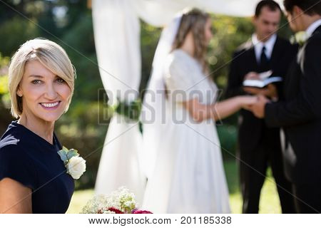 Portrait of woman smiling in park during wedding