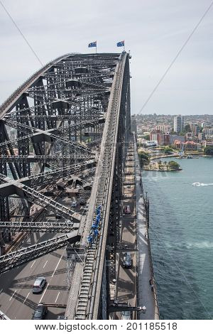 SYDNEY,NSW,AUSTRALIA-NOVEMBER 20,2016: Sydney Harbour Bridge highway with bridge climbers and harbour views in Sydney, Australia.