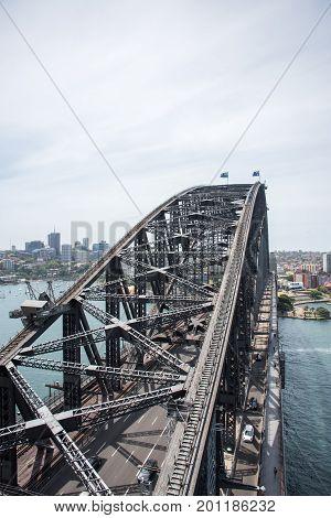 SYDNEY,NSW,AUSTRALIA-NOVEMBER 20,2016: Sydney Harbour Bridge with bridge climbers and highway overlooking harbour in Sydney, Australia.
