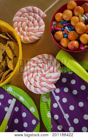 Confectioneries and decorated plates on a table at home