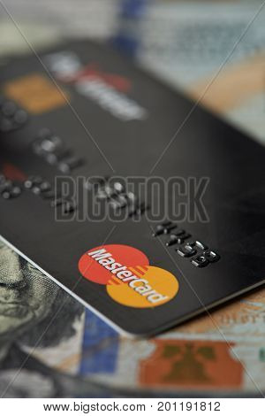 New york, USA - August 24, 2017: Debit master card lay on dollar bill background